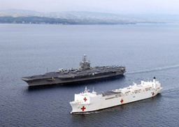 Indian Ocean (Feb. 3, 2005) - The Military Sealift Command (MSC) hospital ship USNS Mercy (T-AH 19) navigates alongside USS Abraham Lincoln (CVN 72) after arriving on station near Banda Aceh, Sumamtra, Indonesia.(RELEASED)